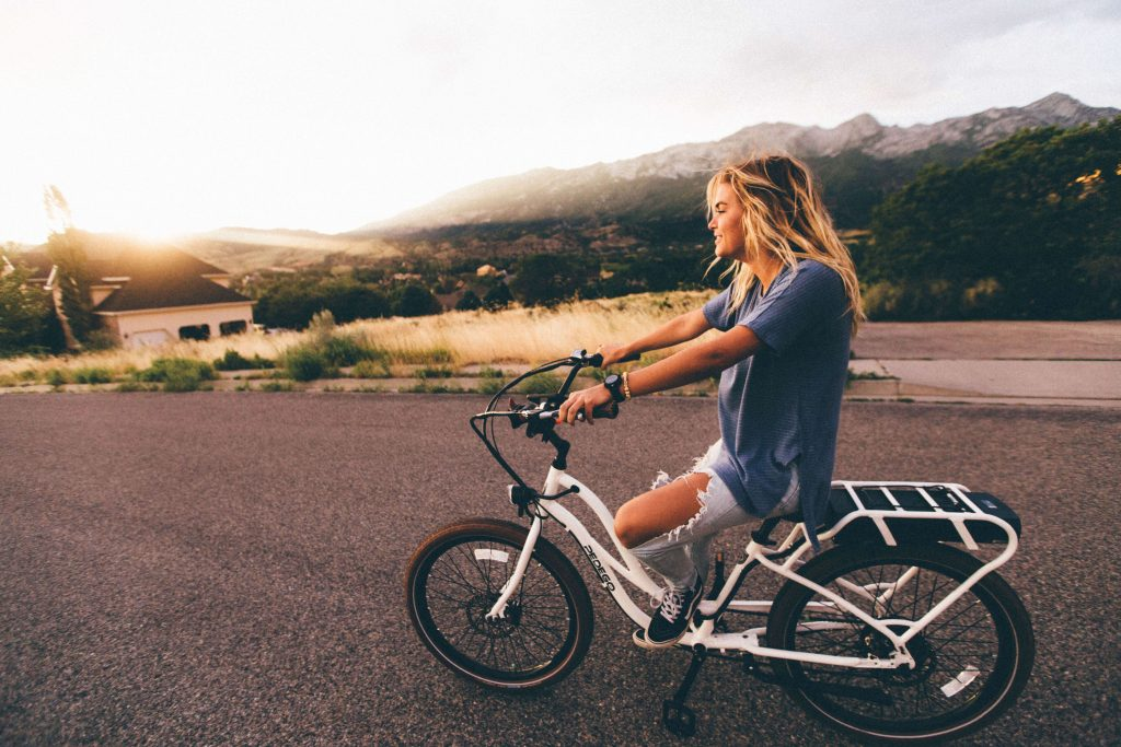 Girl practicing her cycling skills on an empty road